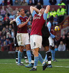 Villa striker James Milner screams in despair after a near miss during the Barclays Premier League match between Aston Villa and Chelsea at Villa Park on February 21, 2009 in Birmingham, England.