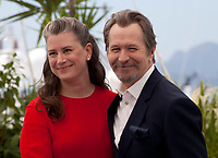 Gary Oldman and  Gisele Schmidt at the Rendezvous with Gary Oldman photo call at the 71st Cannes Film Festival, Thursday 17th May 2018, Cannes, France. Photo credit: Doreen Kennedy
