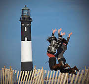 Two girls leaping into the New Year - New Year's Day at Fire Island, 2012