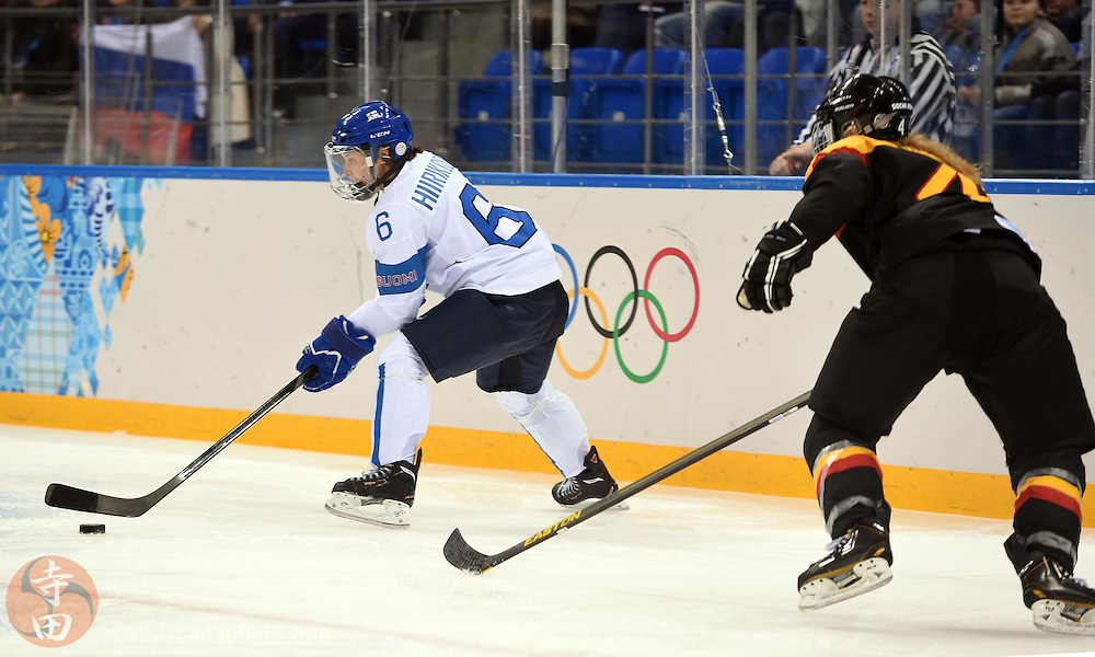 Feb 16, 2014; Sochi, RUSSIA; Finland defenseman Jenni Hiirikoski (6) reaches for the puck against Germany in the women's ice hockey classifications round during the Sochi 2014 Olympic Winter Games at Shayba Arena.