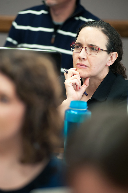 Diane Cahill listens during  a classroom session for an online MBA class. Photo by: Ross Brinkerhoff.