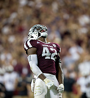 Texas A&M linebacker Otaro Alaka (42) reacts after sacking South Carolina quarterback Jake Bentley (19) during the fourth quarter of an NCAA college football game Saturday, Sept. 30, 2017, in College Station, Texas. (AP Photo/Sam Craft)