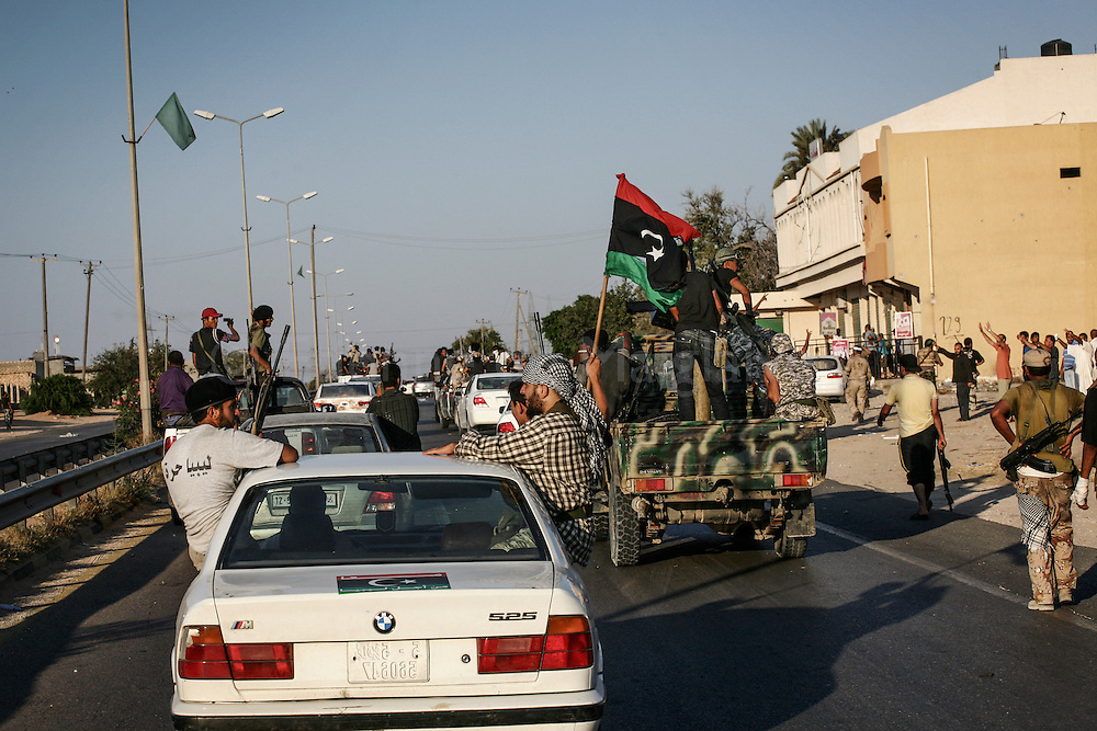 Rebels fighters march from Zawiyah toward Libyan capital Tripoli. 21 August 211.