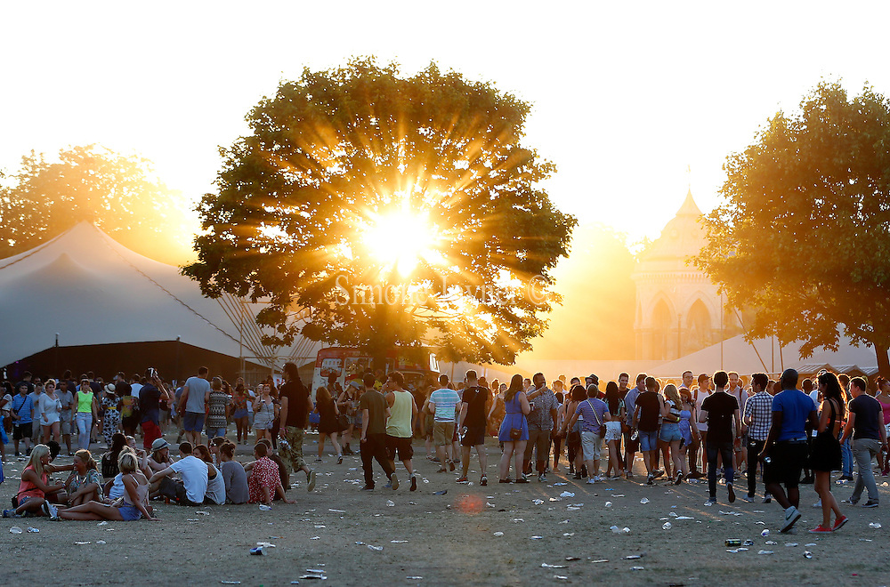 The sun begins to set brhind the trees as music fans make their way round the site on Day 1 of the Lovebox festival at Victoria Park on July 19, 2013 in London, England.  (Photo by Simone Joyner)