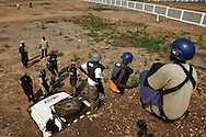 Deminers from Mines Advisory Group (MAG) survey the rooftop of a former military barracks and weapons store used by northern government forces during Sudan's civil war. The building is next to an open area near the John Garang memorial where Independence ceremonies will be held on July 9th, 2011. The area is heavily contaminated with unexploded ordinance (UXO). The Government of South Sudan asked MAG to help SPLA deminers clear the area before the independance celebrations..Juba, South Sudan. 05/07/2011..Photo © J.B. Russell
