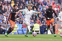 Real Madrid's Karim Benzema and Valencia CF's Daniel Parejo and Eliaquim Mangala during La Liga match between Real Madrid and Valencia CF at Santiago Bernabeu Stadium in Madrid, April 29, 2017. Spain.<br /> (ALTERPHOTOS/BorjaB.Hojas)