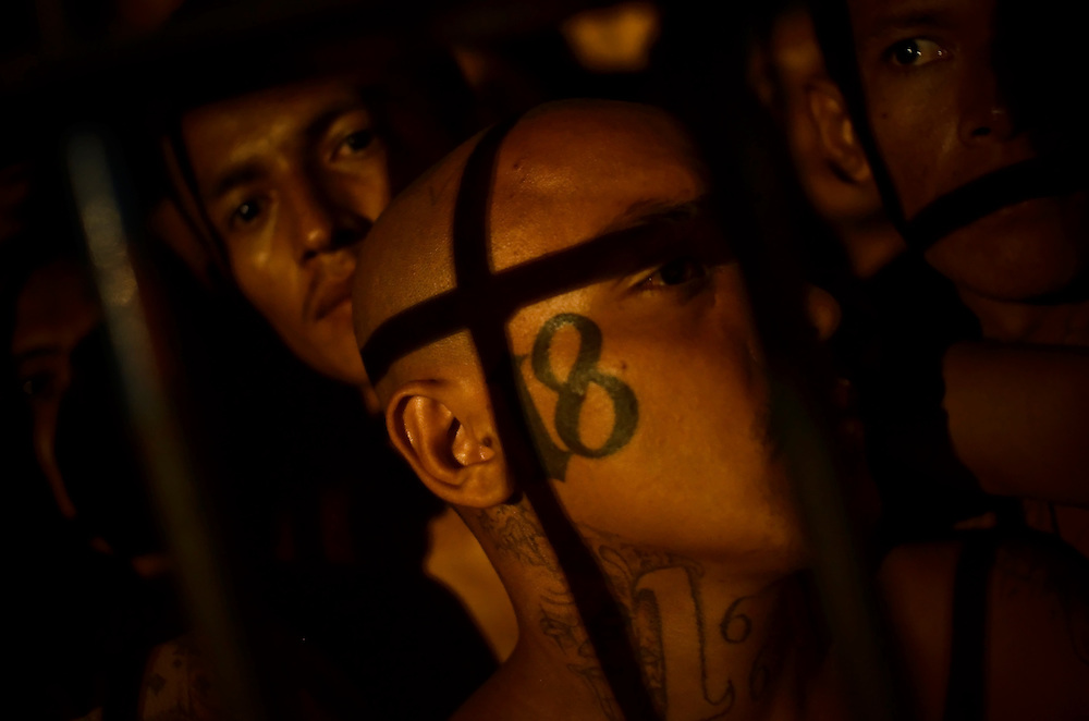 Members of the Mara 18 gang incarcerated in Izalco men's prison in El Salvador inside their overcrowded cell.
