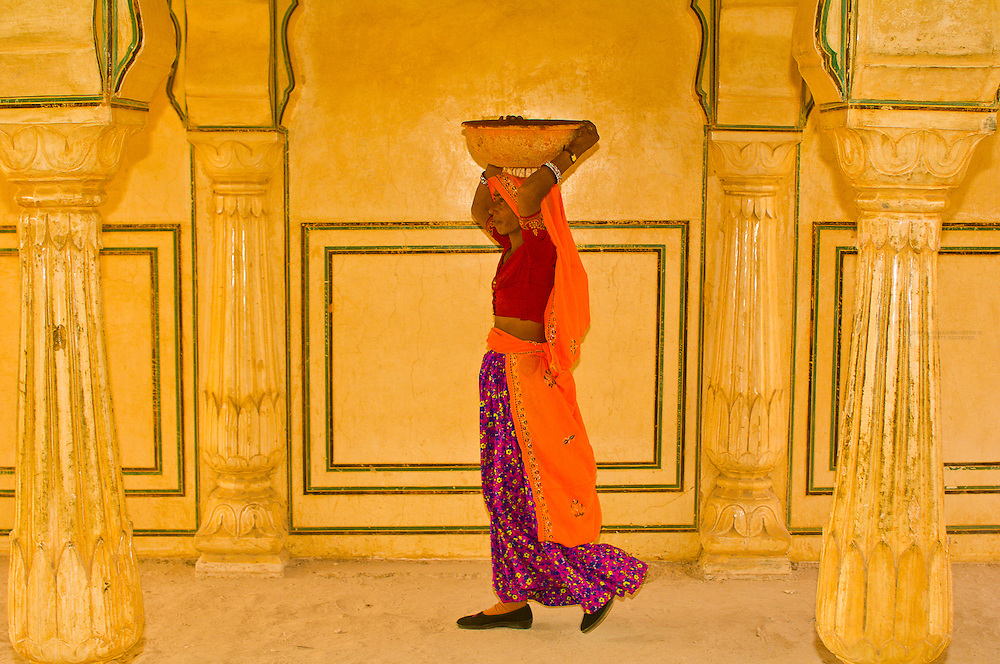 Women walking through arches at the Amber Palace, Amber (near Jaipur), Rajasthan, India