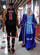 Chicago Bulls' Derrick Rose is congratulated by costume-wearing fan Mikey Gendell after Rose's last second shot gave the Bulls a 82-81 win over the New York Knicks during the NBA team's home opener at the United Center in Chicago, Illinois on Thursday, Oct. 31, 2013.