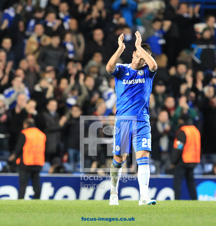 Picture by John Rainford/Focus Images Ltd. 07506 538356.6/12/11.John Terry of Chelsea applaudes the fans at the final whistle against Valencia in the UEFA Champions League match at Stamford Bridge stadium, London.