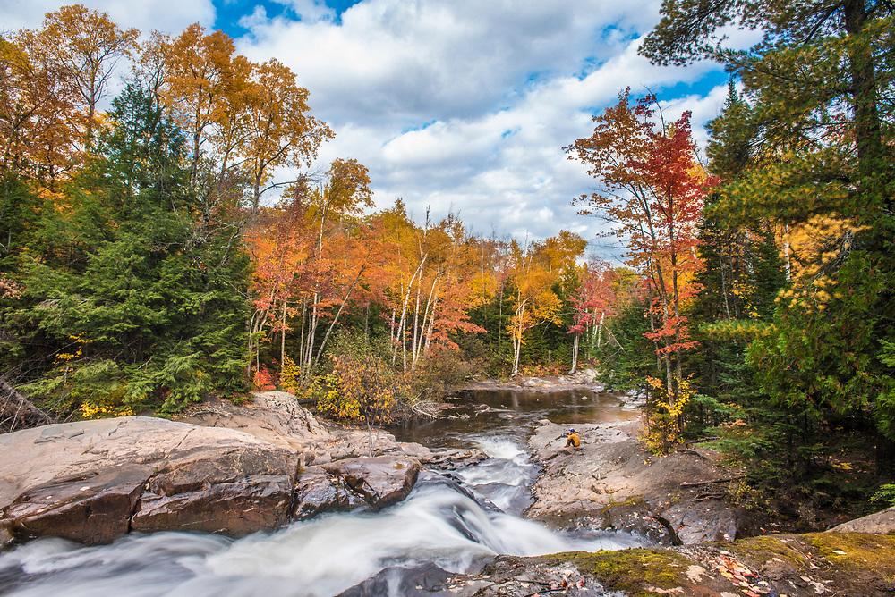 Fall color at Yellow Dog Falls on the Yellow Dog River near Big Bay, Michigan.