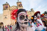 A woman wearing skeleton face paint poses in costume during the Day of the Dead Festival known in spanish as Día de Muertos October 30, 2014 in Oaxaca, Mexico.