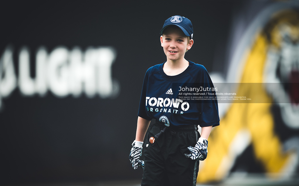 Toronto Argonauts receivers coach Tommy Condell's son Luke before the Labour Day Classic game at Tim Hortons Field in Hamilton ON, Monday September 4, 2017. (Photo: Johany Jutras)