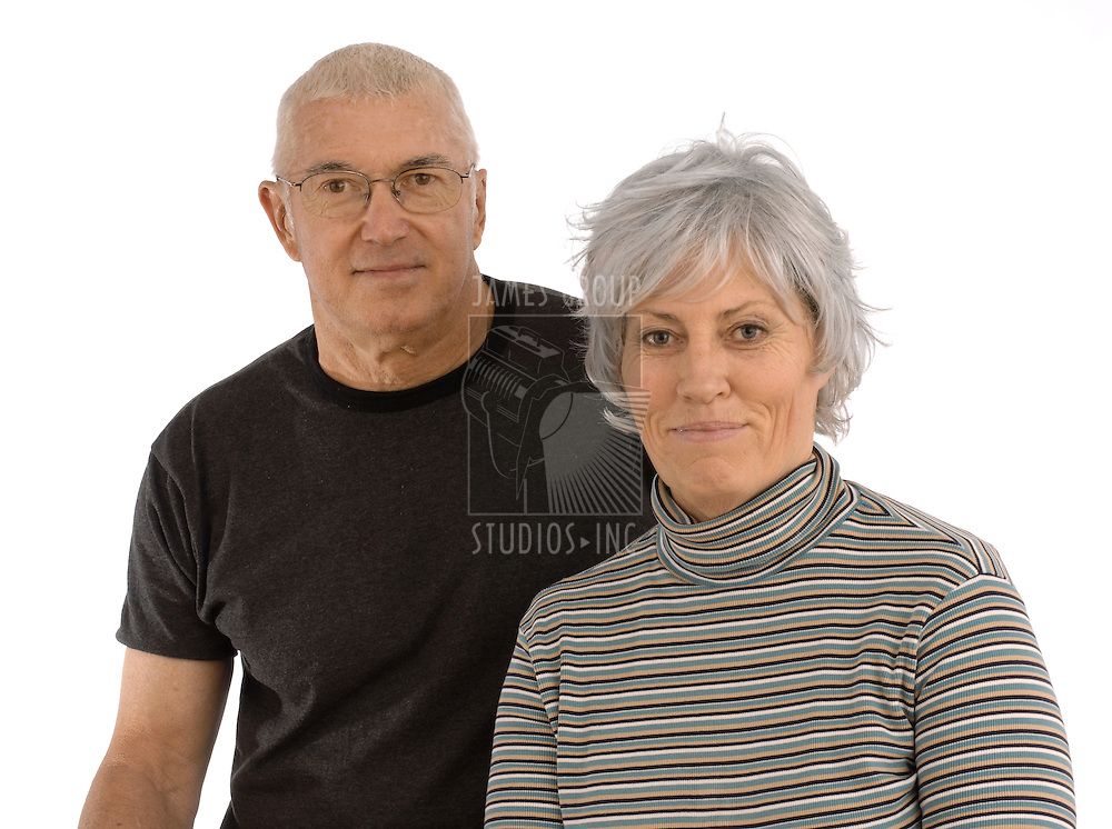 Senior man and woman on a white background