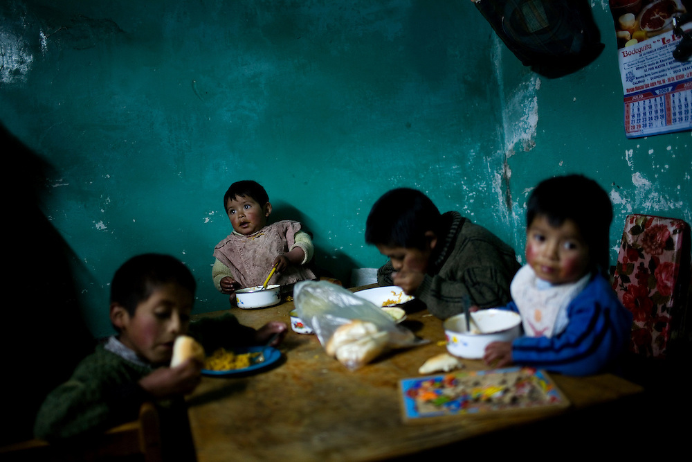 Left to right: Brothers Einer(8), Nixon(2), Dengel(10) and Eric Rivera(3) eat dinner at their home. Dengel has been tested for lead poisoning and has levels more than 4 times the international standard.
