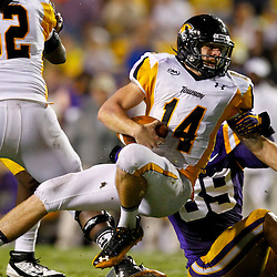 September 29, 2012; Baton Rouge, LA, USA; LSU Tigers defensive end Lavar Edwards (89) sacks Towson Tigers quarterback Grant Enders (14) during the second quarter of a game at Tiger Stadium.  Mandatory Credit: Derick E. Hingle-US PRESSWIRE