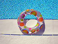 Sarasota, Florida: April 2008--  A life preserver perches on the edge of a swimming pool. © Audrey C. Tiernan