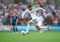 SWANSEA, WALES - Sunday, October 2, 2011: Swansea City's Danny Graham bursts through to score the second goal against Stoke City during the Premiership match at the Liberty Stadium. (Pic by David Rawcliffe/Propaganda)