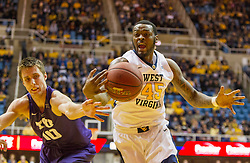 Feb 13, 2016; Morgantown, WV, USA; West Virginia Mountaineers forward Elijah Macon (45) and TCU Horned Frogs forward Vladimir Brodziansky (10) fight for a loose ball during the first half at the WVU Coliseum. Mandatory Credit: Ben Queen-USA TODAY Sports