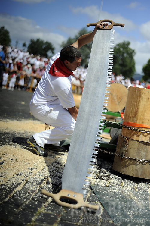 A man holds a tronza (traditional Basque saw) during a rural Basque sports championship, on July 8, 2012, during San Fermin Festival, in the Northern Spanish city of Pamplona. PHOTO / Rafa Rivas