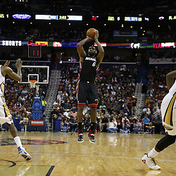 Mar 22, 2014; New Orleans, LA, USA; Miami Heat forward LeBron James (6) shoots against the New Orleans Pelicans during the second half of a game at the Smoothie King Center. The Pelicans defeated the Heat 105-95. Mandatory Credit: Derick E. Hingle-USA TODAY Sports