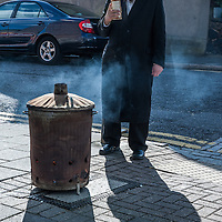 London, UK - 14 April 2014: On the morning before Passover, a member of the Jewish Community of Stamford Hill burns all the chametz (leavened products) during the bi'ur ceremony