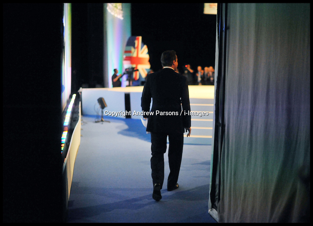 The Prime Minister David Cameron walks on stage to deliver his speech to the Conservative Party Conference in Manchester, Wednesday October 5, 2011. Photo By Andrew Parsons / i-Images.