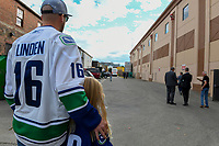 KELOWNA, BC - SEPTEMBER 29:  Fans stand in the alleyway as the bus carrying the Vancouver Canucks' backs up to the dressing room at Prospera Place on September 29, 2018 in Kelowna, Canada. (Photo by Marissa Baecker/NHLI via Getty Images)  *** Local Caption *** fans