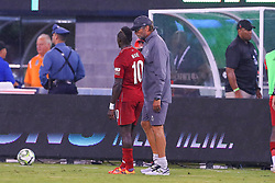 July 25, 2018 - East Rutherford, NJ, U.S. - EAST RUTHERFORD, NJ - JULY 25:  Liverpool head coach Jurgen Klopp talks with Liverpool forward Sadio Mane (10) during halftime of the International Champions Cup Soccer game between Liverpool and Manchester City on July 25, 2018 at Met Life Stadium in East Rutherford, NJ.  (Photo by Rich Graessle/Icon Sportswire) (Credit Image: © Rich Graessle/Icon SMI via ZUMA Press)