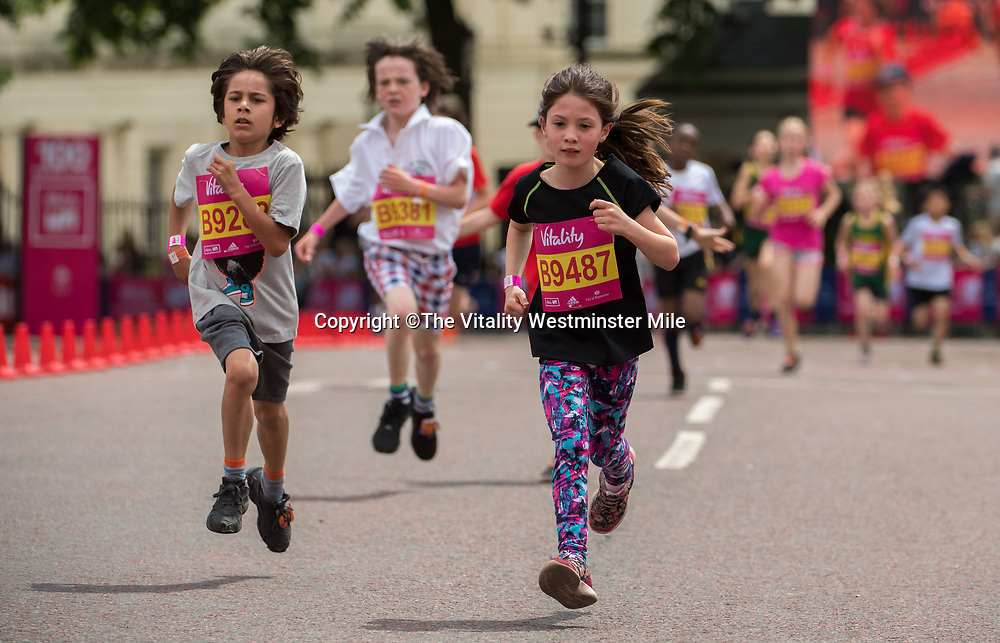Finishers in the Daily Mile London wave at the finishing line outside Buckingham Palace at The Vitality Westminster Mile, Sunday 28th May 2017.<br /> <br /> Photo: Thomas Lovelock for The Vitality Westminster Mile<br /> <br /> For further information: media@londonmarathonevents.co.uk