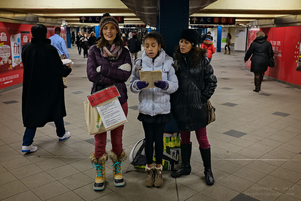 Christmas carolers in subway station, raising money for charity, New York, NY, US