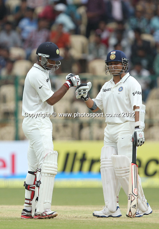 New Zealand cricket tour to India. September 2012 Bengaluru :   India's Sachin Tendulakr and  Cheteswar Pujara   during the 4th day of the test match against NewZealand in Bengaluru on Monday.   Photo: Photosport.co.nz
