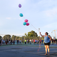 Melissa Boatman releases balloons to conclude the candlelight vigil for Maggie Riley abd Brandon Coward at Nettleton High School Monday evening.