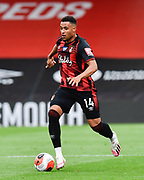 Arnaut Danjuma (14) of AFC Bournemouth on the attack during the Premier League match between Bournemouth and Newcastle United at the Vitality Stadium, Bournemouth, England on 1 July 2020.