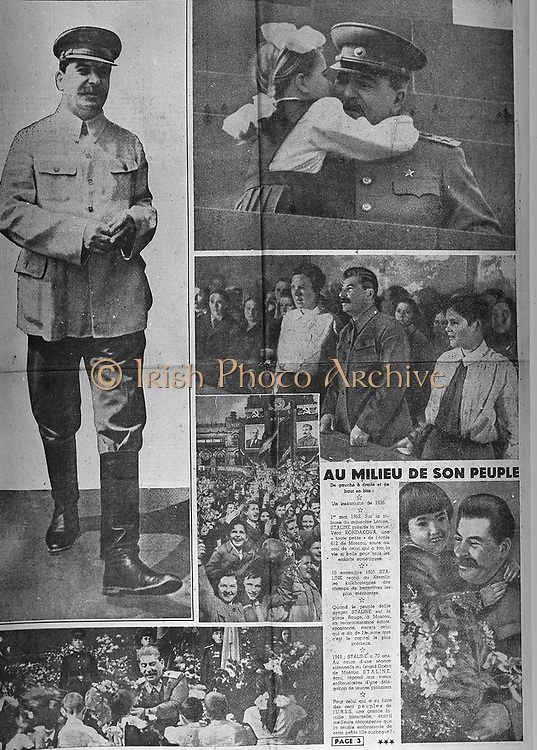 Joseph Stalin (1879-1953) Russian dictator,  embracing a little girl who has presented him with a boquet. 1940s