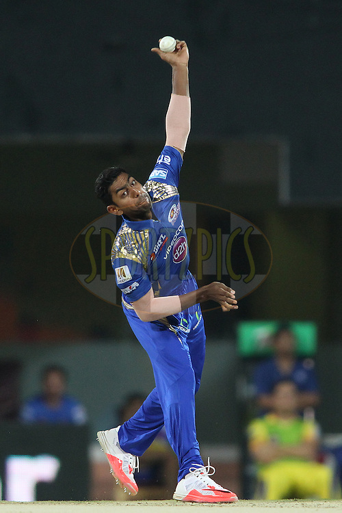 J Suchith of Mumbai Indians sends down a delivery during match 43 of the Pepsi IPL 2015 (Indian Premier League) between The Chennai Super Kings and The Mumbai Indians held at the M. A. Chidambaram Stadium, Chennai Stadium in Chennai, India on the 8th May April 2015.<br /> <br /> Photo by:  Shaun Roy / SPORTZPICS / IPL