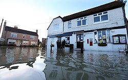 Boxing Day floods.. Residents in Yalding, Kent survey the scene in their flooded village as they brace themselves for the possibility of  more flooding with another storm on the way, Thursday, 26th December 2013. Picture by Stephen Lock / i-Images