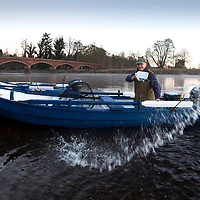 Calum McRoberts, Head Ghillie at the Meikleour Fishings on the River Tay near Blairgowrie in Perthshire making final preparations to his nets and boats for the opening day of the Tay Salmon Season tomorrow….14.01.19<br />Picture by Graeme Hart.<br />Copyright Perthshire Picture Agency<br />Tel: 01738 623350  Mobile: 07990 594431