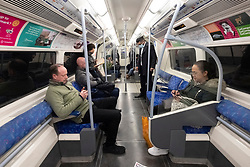 © Licensed to London News Pictures. 18/03/2020. London, UK. Commuters travel on an underground train during the morning rush hour to emptier trains during the Coronavirus outbreak. Photo credit: Ray Tang/LNP