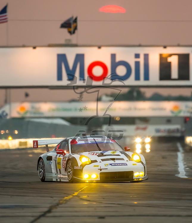 Sebring, FL - Mar 19, 2015:  The Porsche North America races through the turns at 12 Hours of Sebring at Sebring Raceway in Sebring, FL.