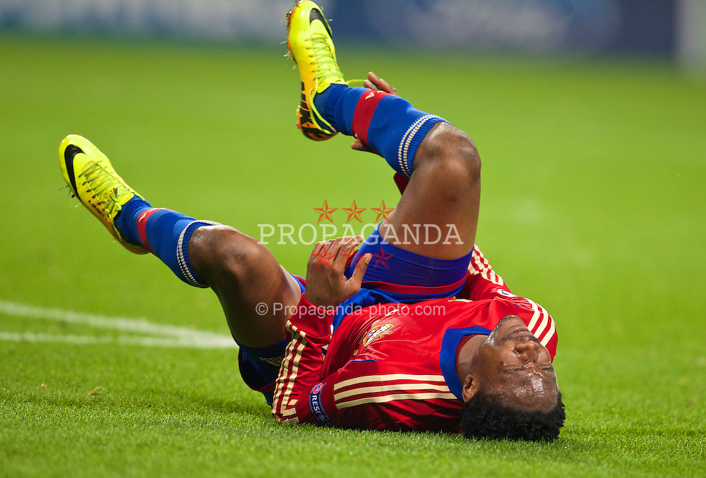 MANCHESTER, ENGLAND - Tuesday, November 5, 2013: CSKA Moscow's Ahmed Musa lies injured during the UEFA Champions League Group D match against Manchester City at the City of Manchester Stadium. (Pic by David Rawcliffe/Propaganda)