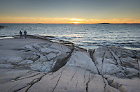Granite shoreline of Peggy's Cove at sunset, Nova Scotia
