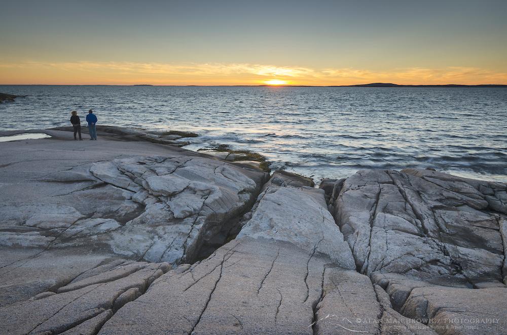 Granite shoreline of Peggy's Cove at sunset, Nova Scotia