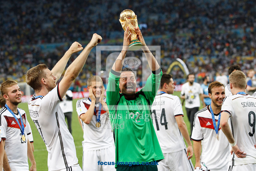 Germany's Roman Weidenfeller celebrates winning the 2014 FIFA World Cup Final at Maracana Stadium, Rio de Janeiro<br /> Picture by Andrew Tobin/Focus Images Ltd +44 7710 761829<br /> 13/07/2014