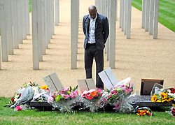 FILE PHOTOGRAPH © under license to London News Pictures. UK 07/07/2010. Relatives at memorial. An unofficial ceremony is held in Hyde Park to mark the fifth anniversary of the 7 July bombings in the capital. Survivors and families of those who lost their lives in the terror attacks laid down flowers by 52 steel pillars which represent those killed.
