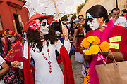 A group of women wearing skeleton costumes parade during the Day of the Dead Festival known in spanish as Día de Muertos October 28, 2014 in Oaxaca, Mexico.
