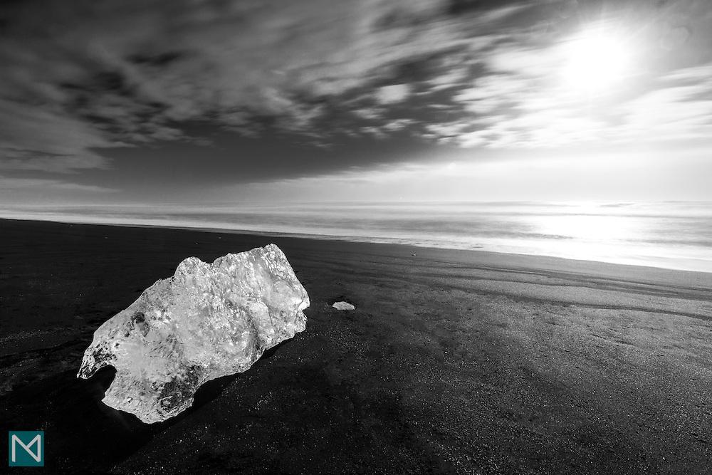 An iceberg washed up on the black sand beach near Jökulsárlón glacier lagoon in southern Iceland