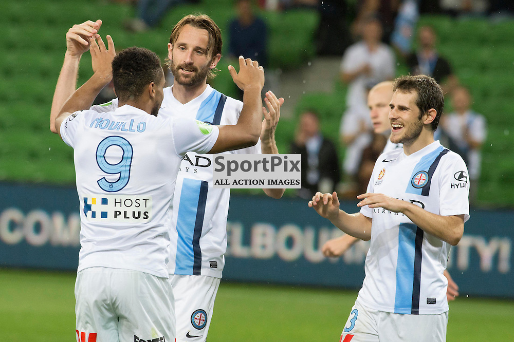 Harry Novillo (Melbourne City) celebrates his goal with team mates Josh Kennedy and Mate Duganzic in the Hyundai A-League, 14th March 2015, RD 21- match between Melbourne City FC v Newcastle Jets at Aami Park, Melbourne Australia. © Mark Avellino | SportPix.org.uk Final score City 4:0 Newcastle