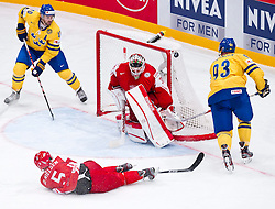 07.05.2012, Ericsson Globe, Stockholm, SWE, IIHF, Eishockey WM, Schweden vs Daenemark, im Bild Sverige Sweden 93 Johan Franzen shoots against Denmark 30 Goalkeeper Frederik Andersen (Fr?lunda), Denmark 5 Daniel Nilsen (Hamburg Freezers), Sverige Sweden 40 Henrik Zetterberg // during the IIHF Icehockey World Championship Game between Sweden vs Danmark at the Ericsson Globe, Stockholm, Sweden on 2012/05/07. EXPA Pictures © 2012, PhotoCredit: EXPA/ PicAgency Skycam/ ATTENTION - OUT OF SWE *****