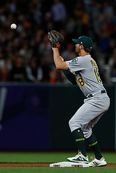 SAN FRANCISCO, CA - AUGUST 13: Chad Pinder #18 of the Oakland Athletics catches a throw for a force out at second base during the eighth inning against the San Francisco Giants at Oracle Park on August 13, 2019 in San Francisco, California. The San Francisco Giants defeated the Oakland Athletics 3-2. (Photo by Jason O. Watson/Getty Images) *** Local Caption *** Chad Pinder
